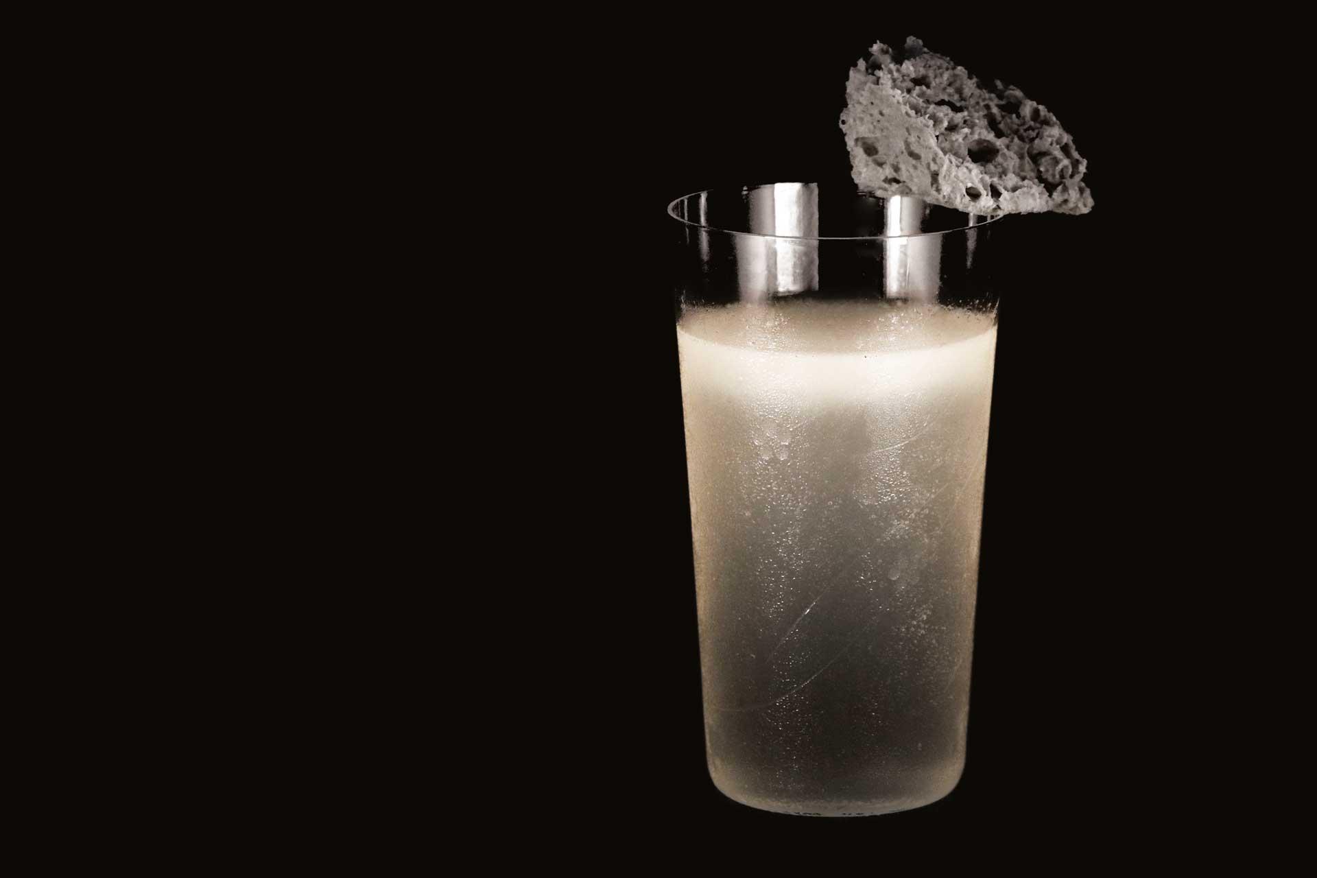 Joe Schofield's Rain cocktail featuring homemade rain spirit and an edible raincloud