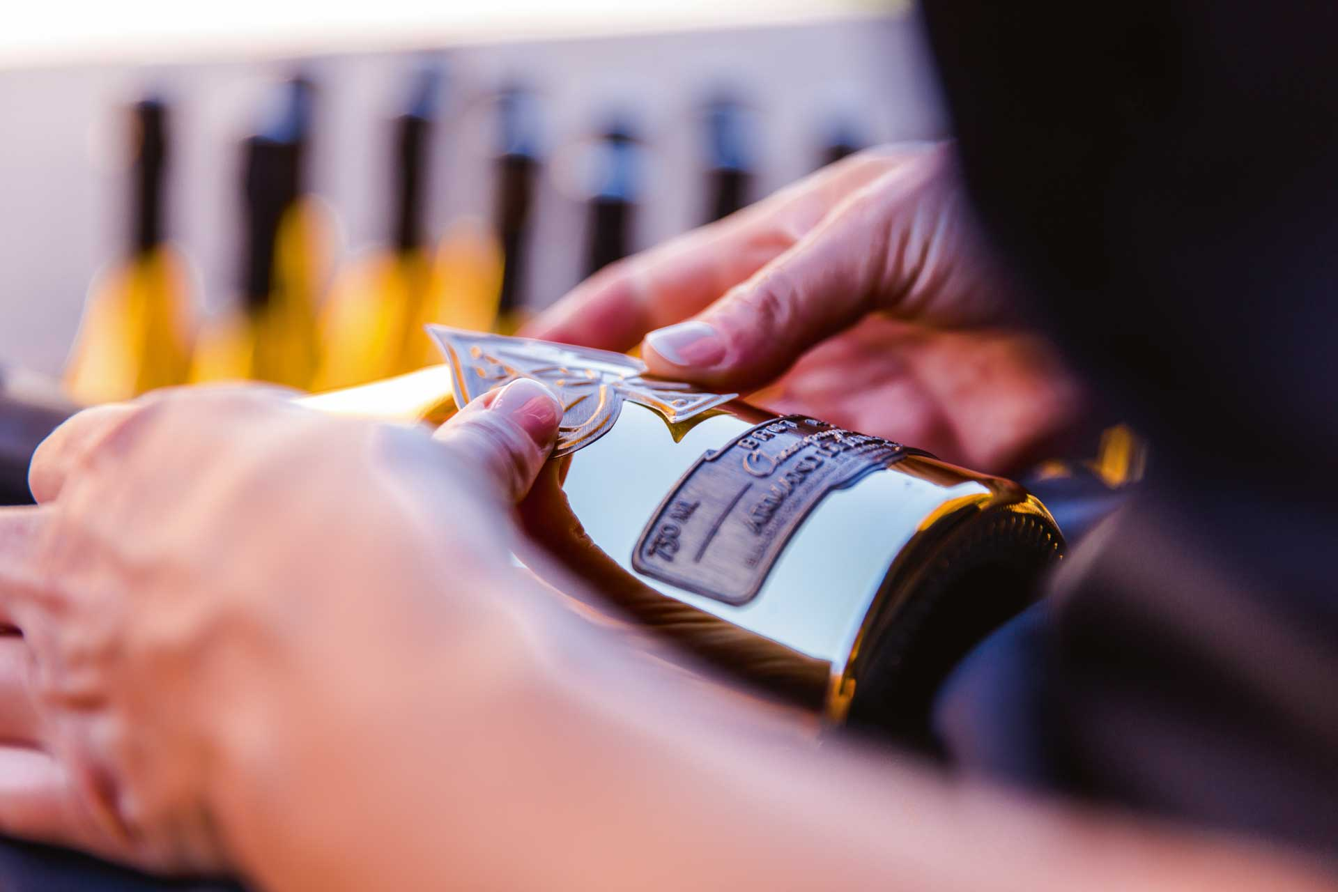 Each bottle of Jay-Z's Armand de Brignac champagne is finished by hand