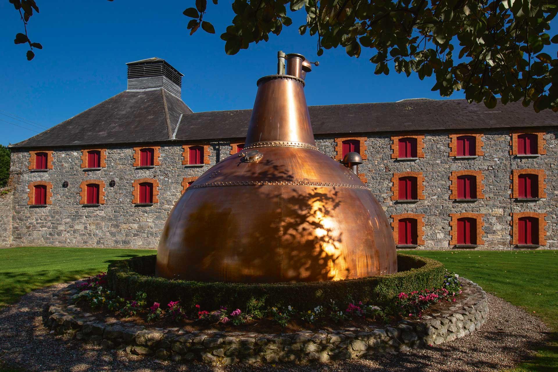 Huge copper pot still outside the old Midleton Distillery