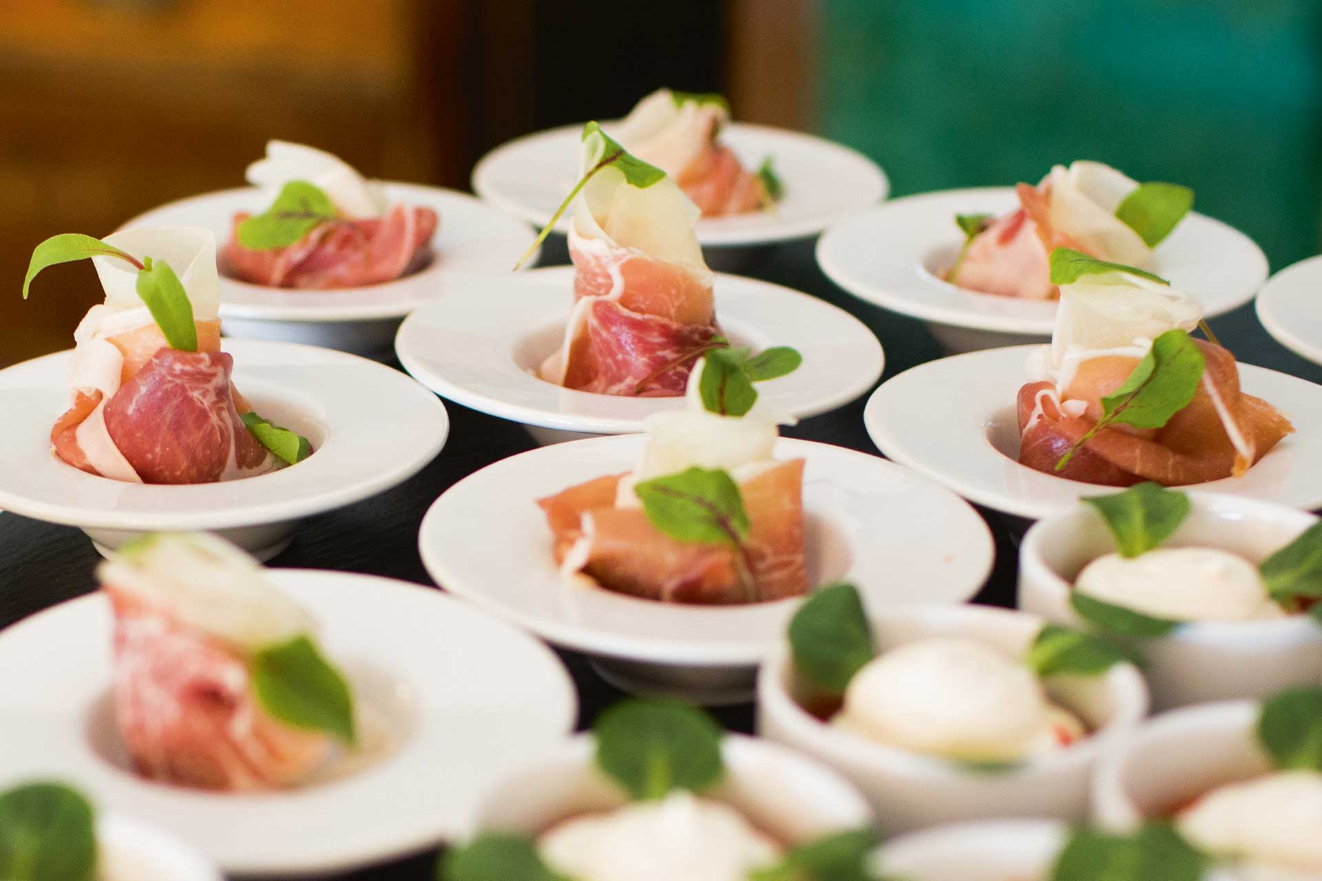 Plates of ham laid out for a large hotel conference