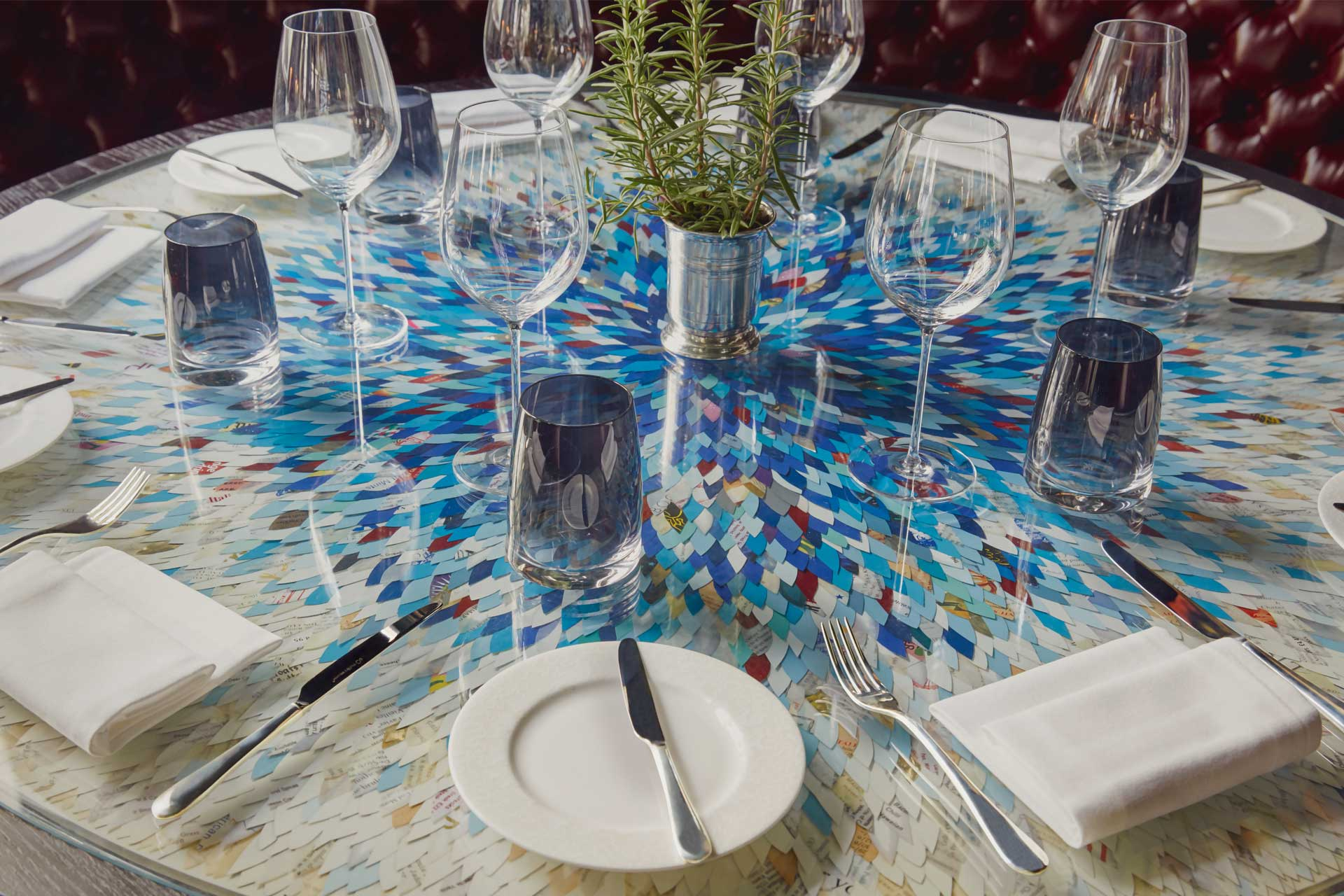 Bespoke tabletop by Robi Walters featuring menus cut into petal shapes