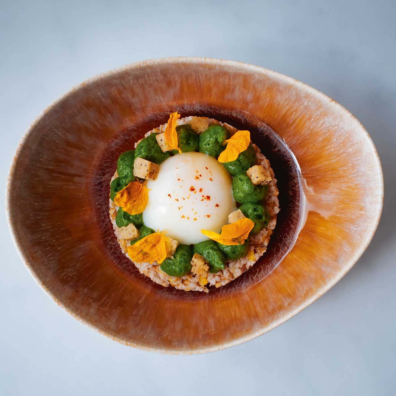Oeuf parfait is one of Le Collectionneur's most eye-catching dishes