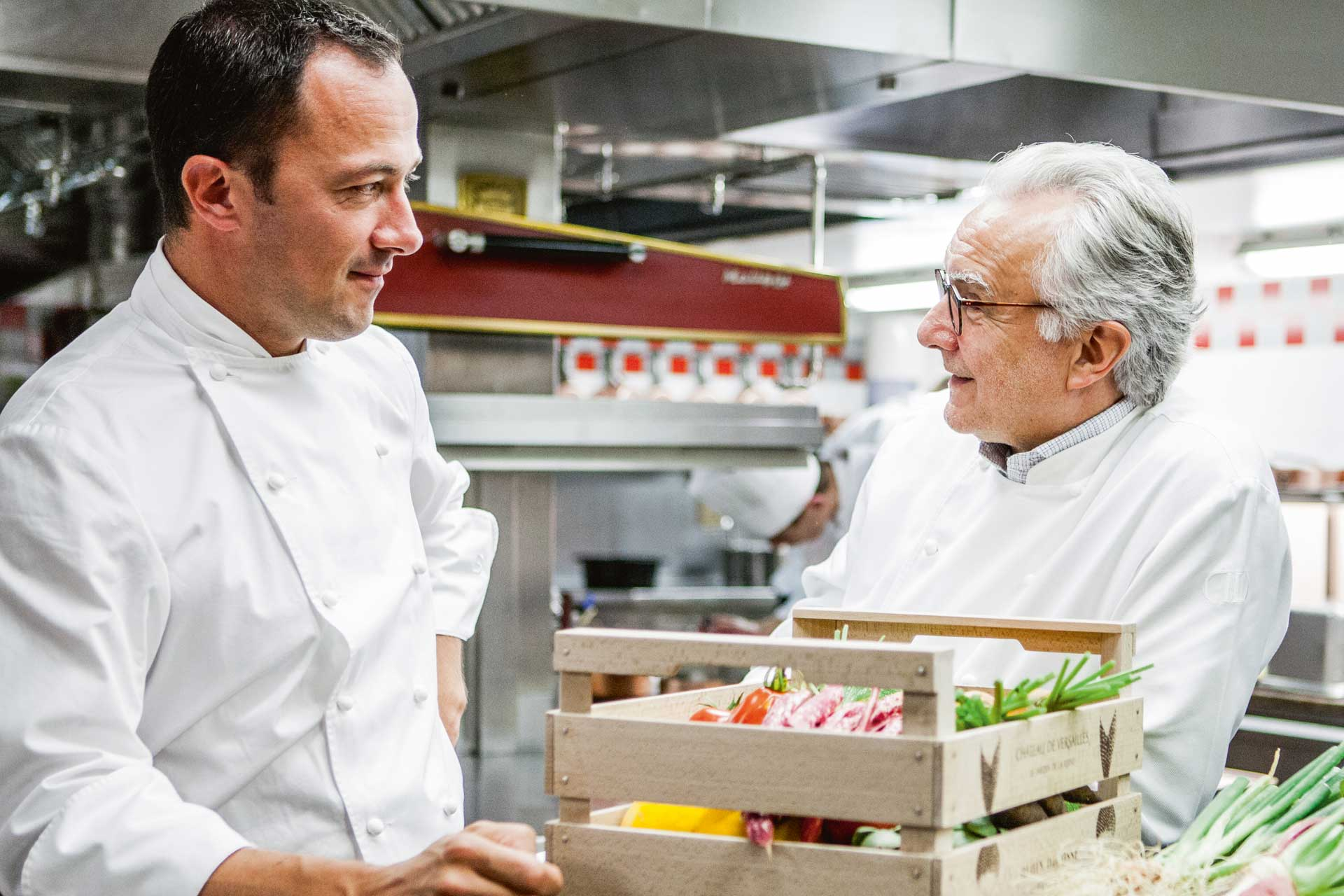 Michelin-starred chefs Romain Meder and Alain Ducasse in the kitchen